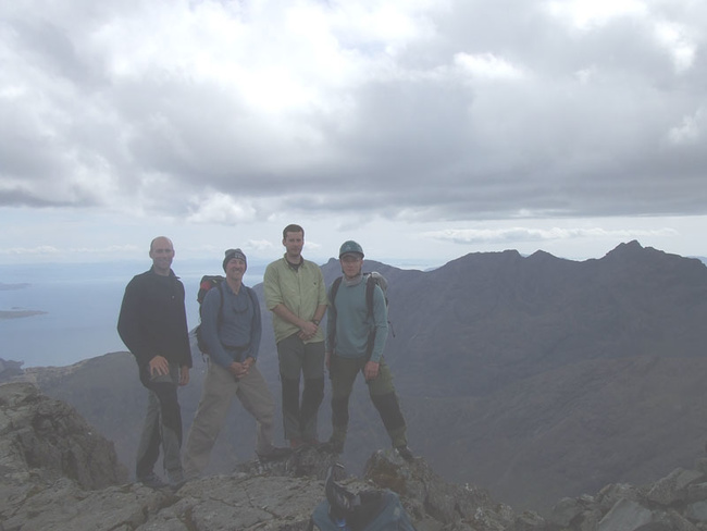 David, Dave, Will and Christian reach the end of the Cuillin Ridge. Hurrah!